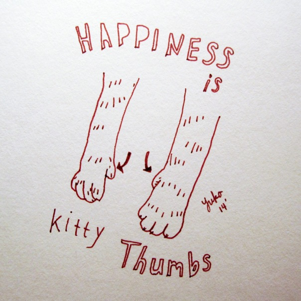 Happiness is kitty thumbs.