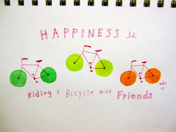 Happiness is riding a bicycle with friends.