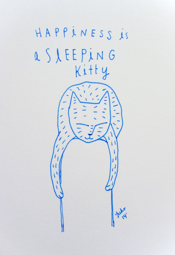 Happiness is a sleeping kitty.