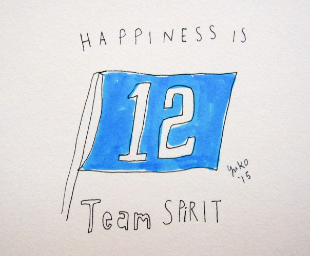 Happiness is team spirit. I'm not even a sports fan, but it was a great game! Go Hawks!