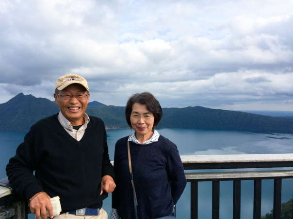 my parents by the Lake Mashu. It was the most beautiful and peaceful lake I've ever seen!