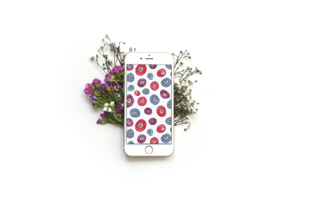 watercolor circle flower red, purple, blue on smartphone screen